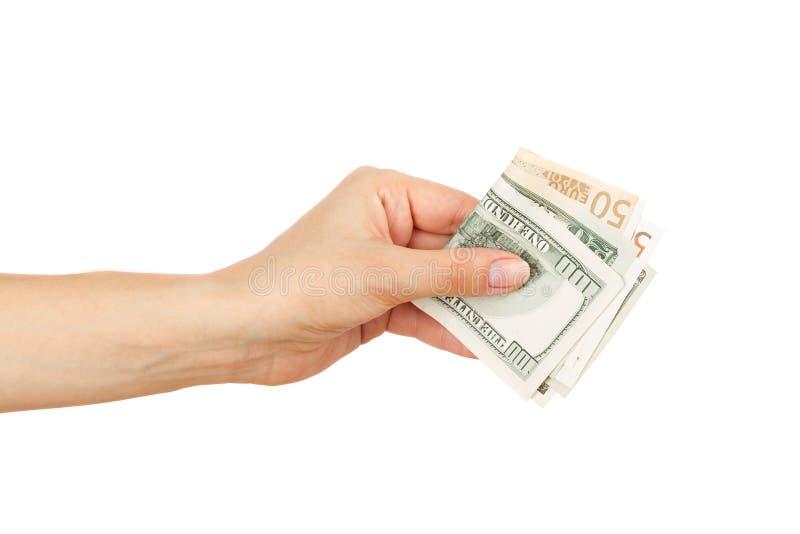 Honderd dollars en Vijftig euro in de vrouwen` s hand stock foto