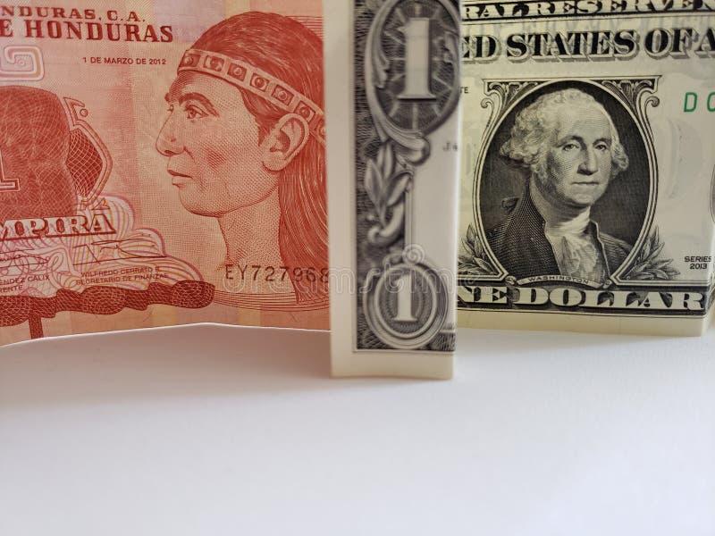 Honduran bankbiljet van één lempira en Amerikaanse dollarrekening royalty-vrije stock afbeeldingen