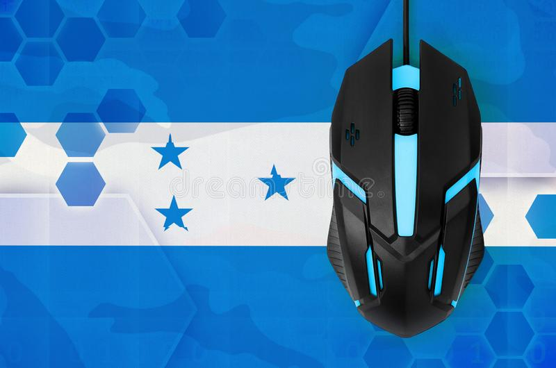 Honduras flag and computer mouse. Concept of country representing e-sports team. Honduras flag and modern backlit computer mouse. Concept of country representing stock images