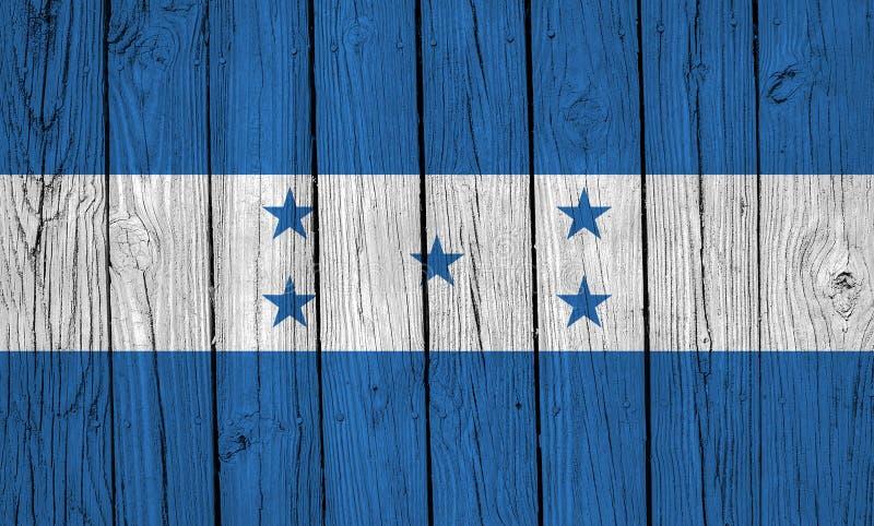 Honduras Flag Over Wood Planks. A grunge Honduras flag over wood planks royalty free stock photos
