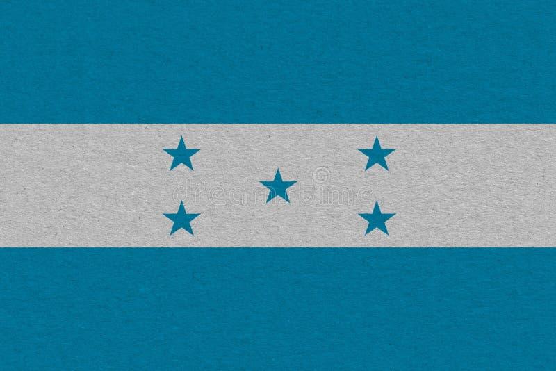 Honduras flag painted on paper. Patriotic background. National flag of Honduras royalty free stock image