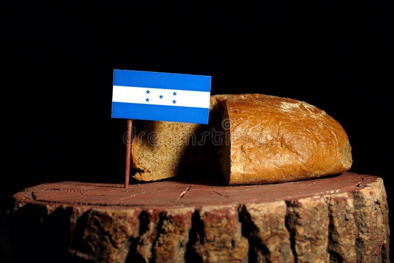 Honduras-Flagge auf einem Stumpf mit Brot lizenzfreie stockfotografie