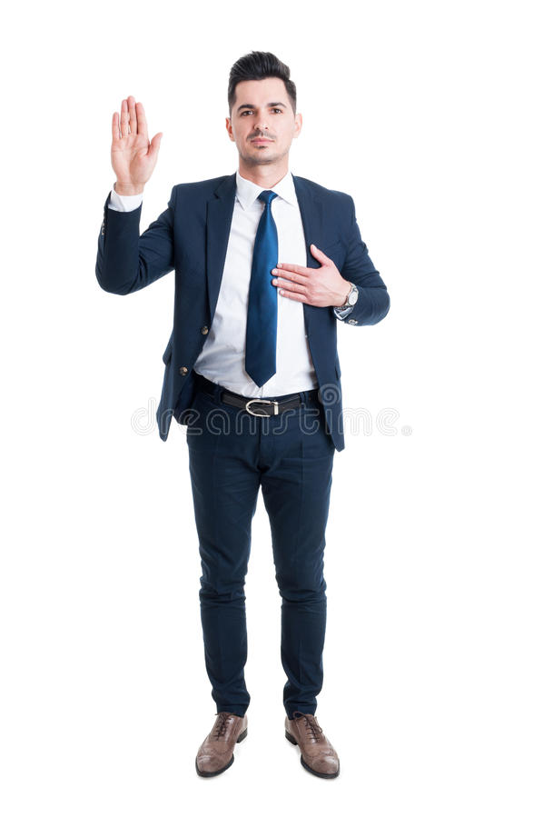 Honest lawyer hand on heart as swear or oath gesture. Isolated on white background royalty free stock photos