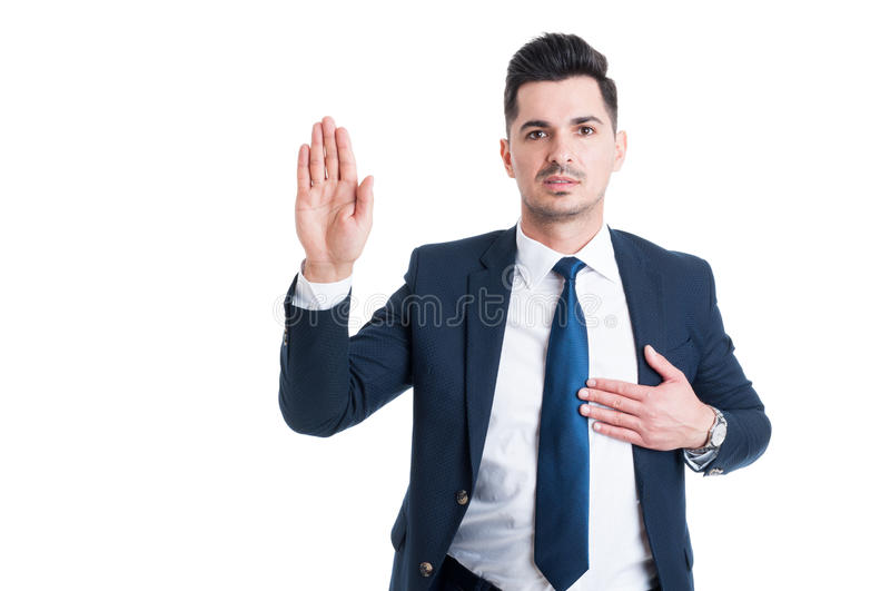 Honest lawyer hand over heart as swear or oath gesture. For law and justice concept royalty free stock photos