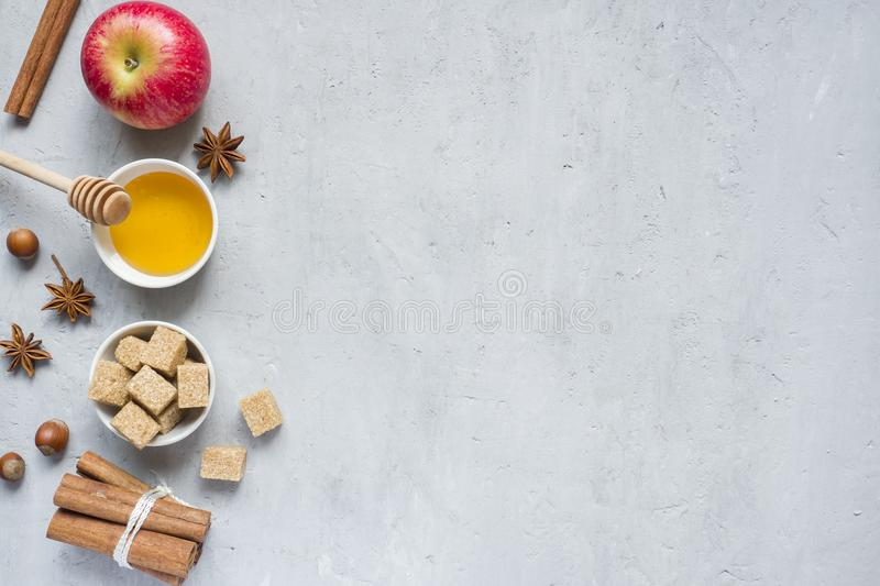 Honey and Apple, brown sugar and anise with cinnamon on a light background copy space for text. royalty free stock images