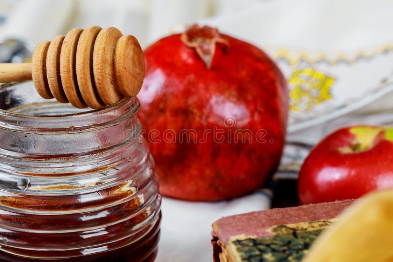 Honey, apple and pomegranate for traditional holiday symbols rosh hashanah jewesh holiday on wooden background. Honey, apple and pomegranate for traditional stock image