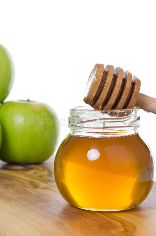 Honey with apples royalty free stock image