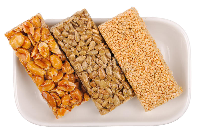 Honey bars with peanuts, sesame. And sunflower seeds isolated royalty free stock photos