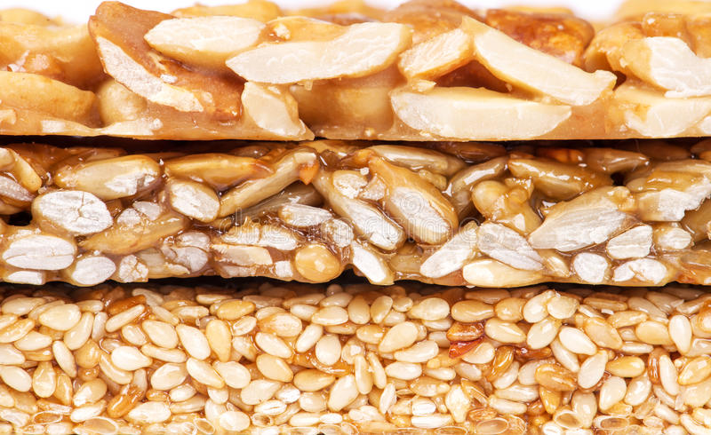 Honey bars with peanuts, sesame and sunflower seeds stock photo