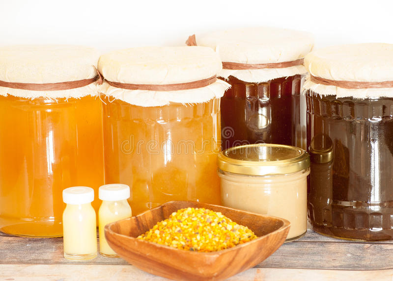 Honey bee products. Variety of raw organic honey bee products stock photography
