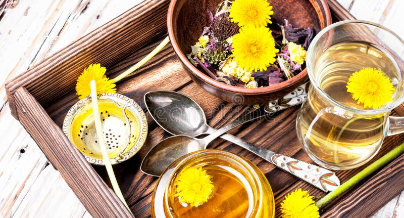 Honey from dandelion and tea royalty free stock photo