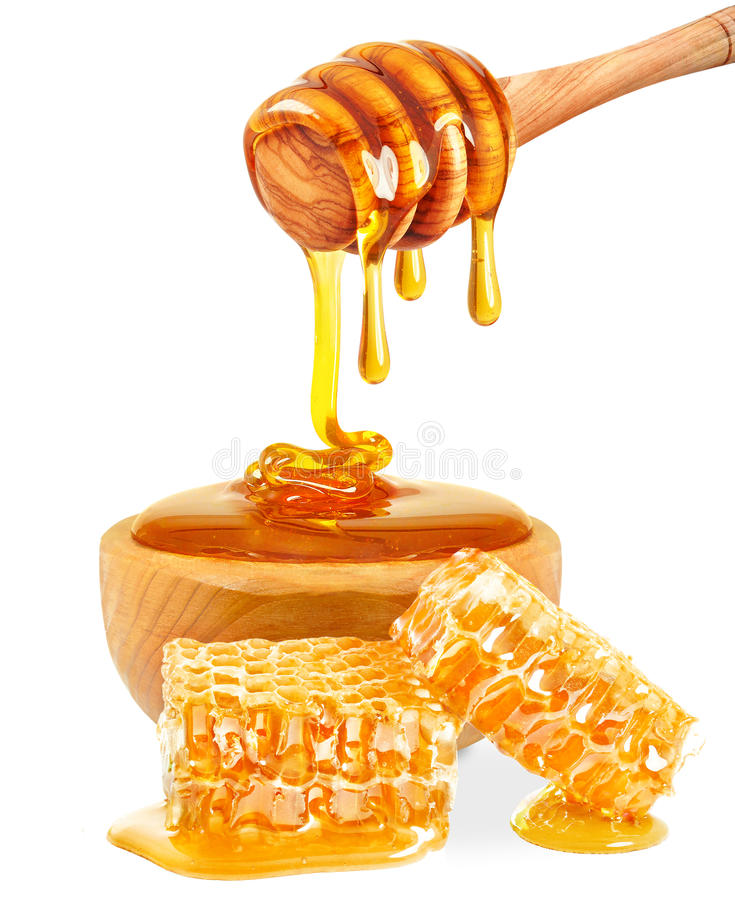 Honey. In a bowl and comb isolated on white background royalty free stock images