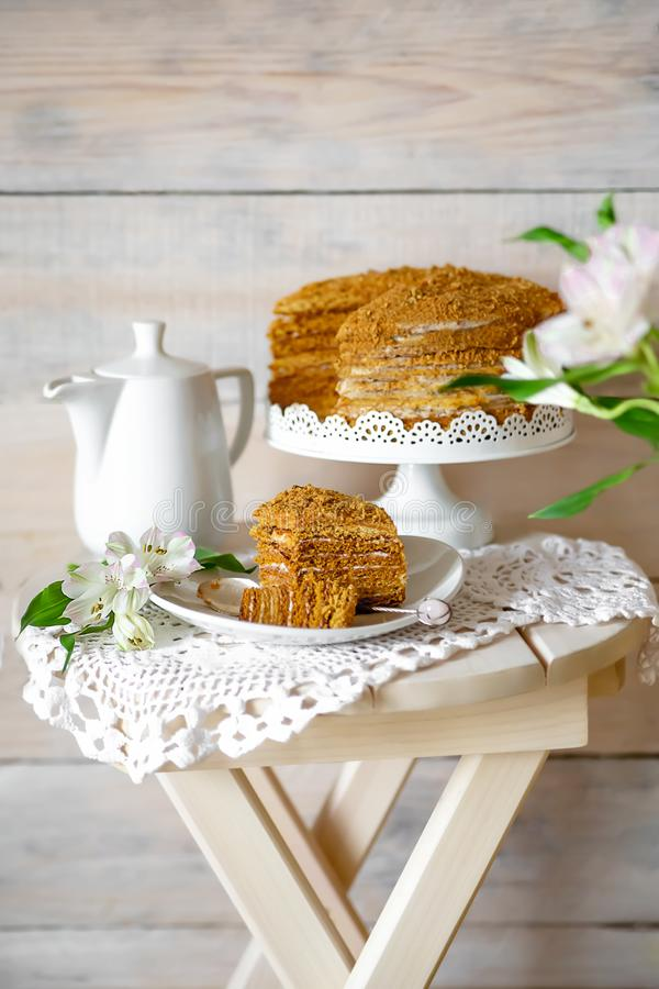 Honey cake with spring flowers royalty free stock photo