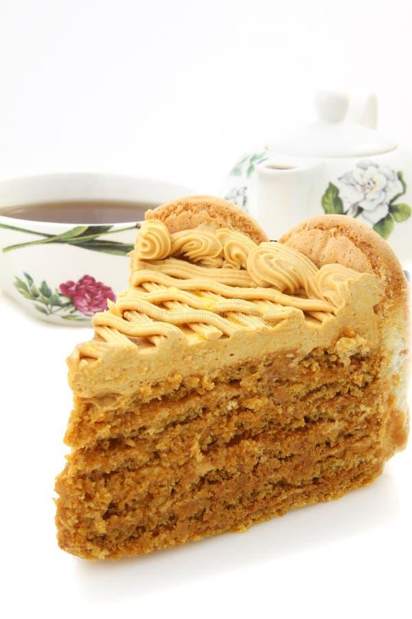 Honey cake and tea stock photo
