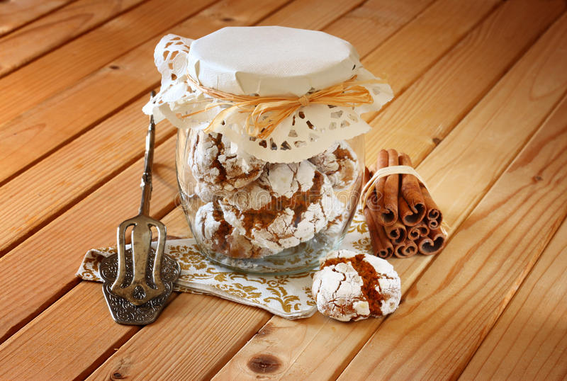 Honey cakes. cookie jar and Cinnamon sticks on wooden table royalty free stock photo