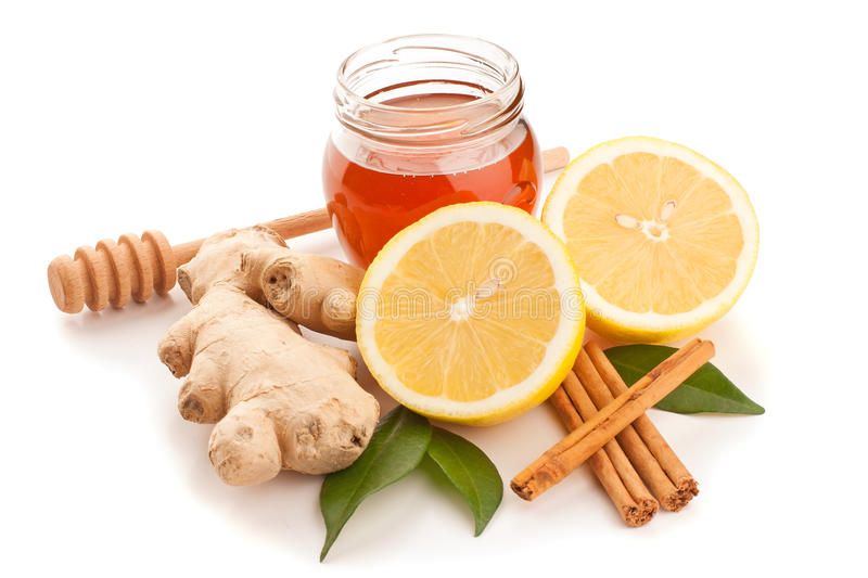 Honey, cinnamon, ginger and lemon royalty free stock image