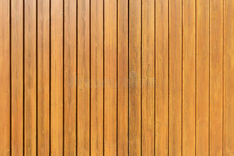 Honey-colored vertical wooden wall stock photography