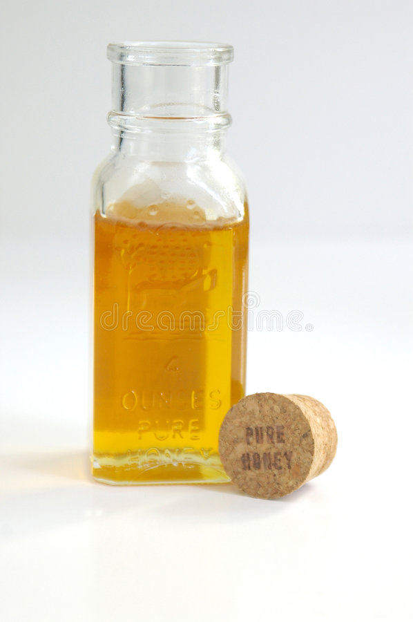 Honey and cork stock image
