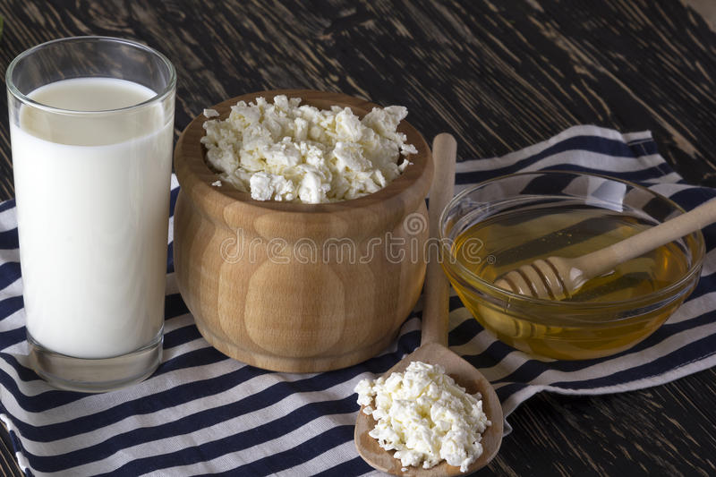 Honey, cottage cheese andglass with milk. royalty free stock photo