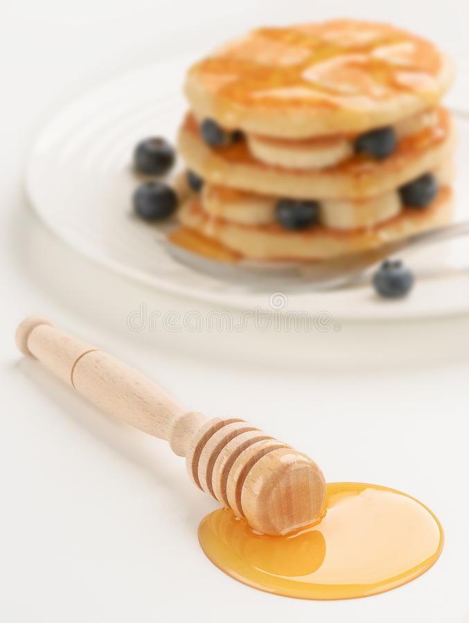 Download Honey Dipper (with Breakfast In Background) Stock Image - Image: 12645879