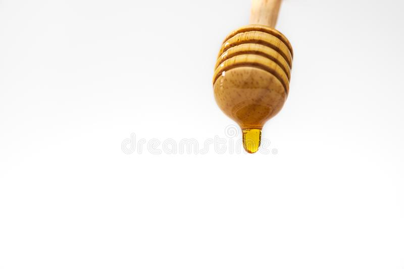 A honey dripper on white background. Food concept.  royalty free stock images