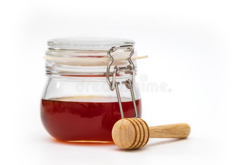 A honey dripper on white background. Food concept.  royalty free stock photos