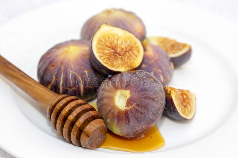 Honey and figs on a plate royalty free stock photography