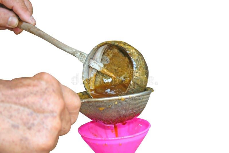 Honey Filtration Process isolou-se no fundo branco fotografia de stock royalty free