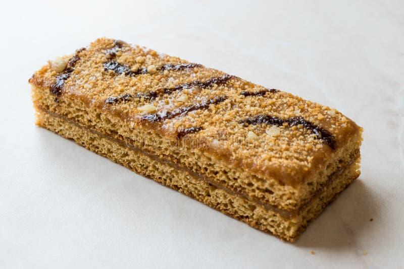 Honey Flavored Energy Bar with Walnut, Milk and Caramel Sauce. Organic Appetizer stock photo