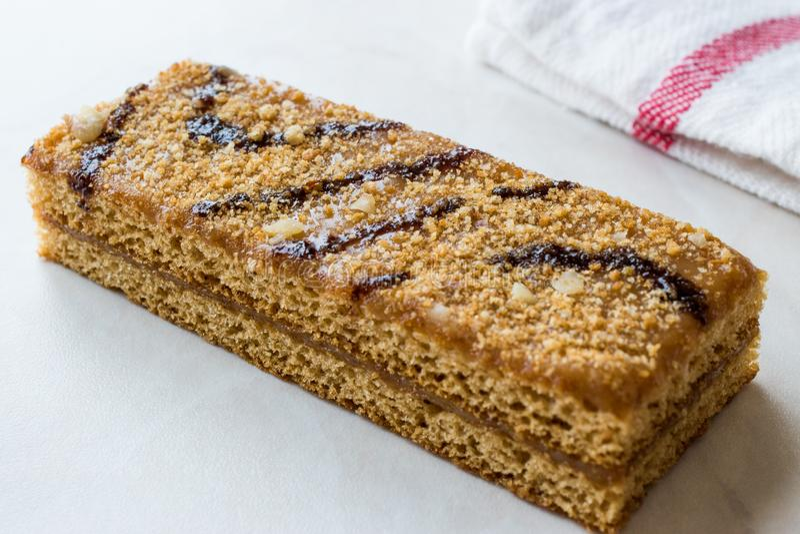 Honey Flavored Energy Bar with Walnut, Milk and Caramel Sauce. Organic Appetizer stock photos