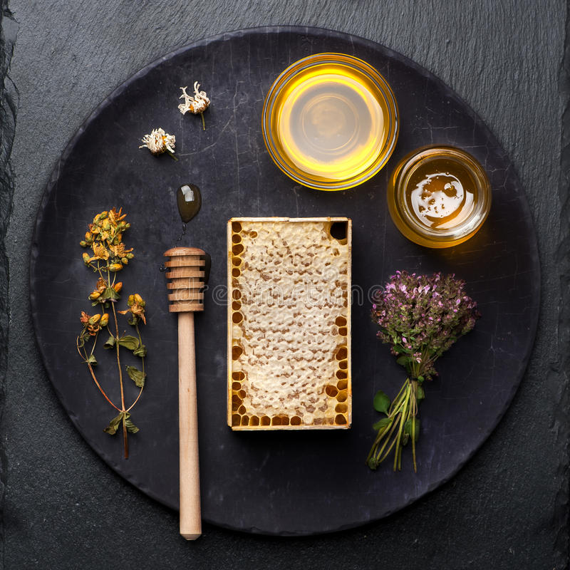 Honey, flowers and herbs royalty free stock image