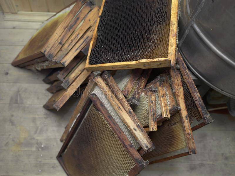 Honey frames in mess. Honey frames laid in mess on the floor, indoor close-up stock images
