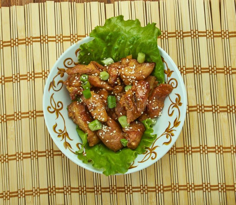 Honey Garlic Baked Pork Bites imagens de stock
