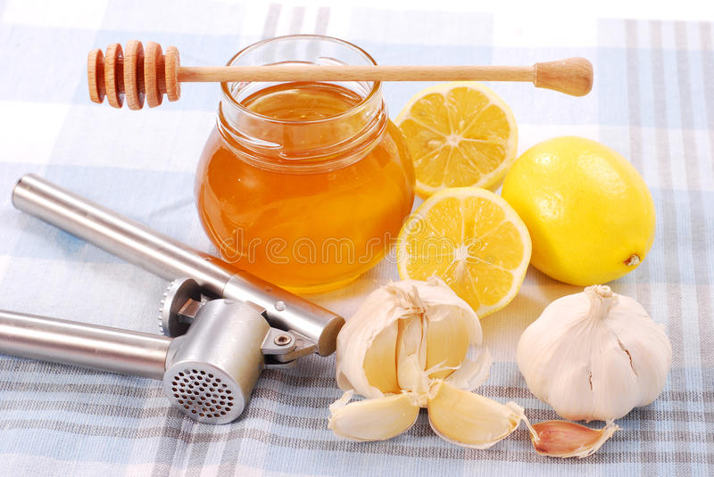 Honey, garlic and lemon stock photo