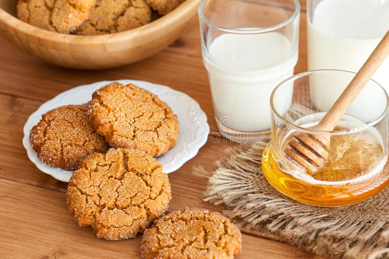Honey ginger cookies with milk on a rustic background. Selective focus royalty free stock images