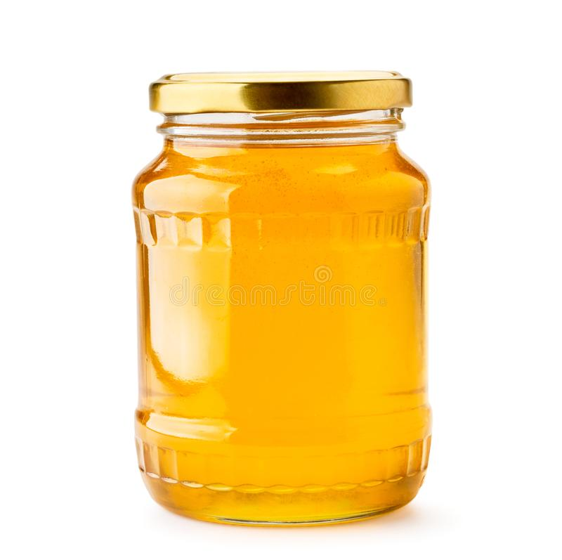 Honey in a glass jar close-up on a white. Isolated. stock images