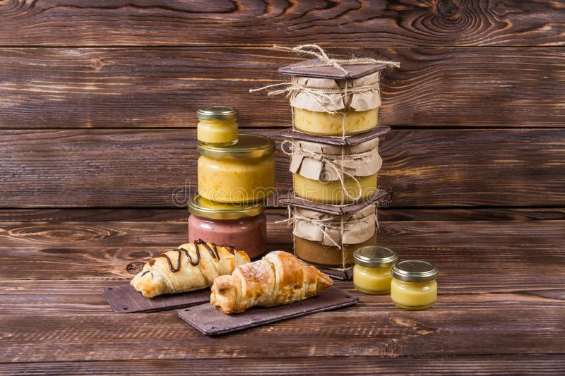 Honey in a glass jar on a dark wooden background royalty free stock photography