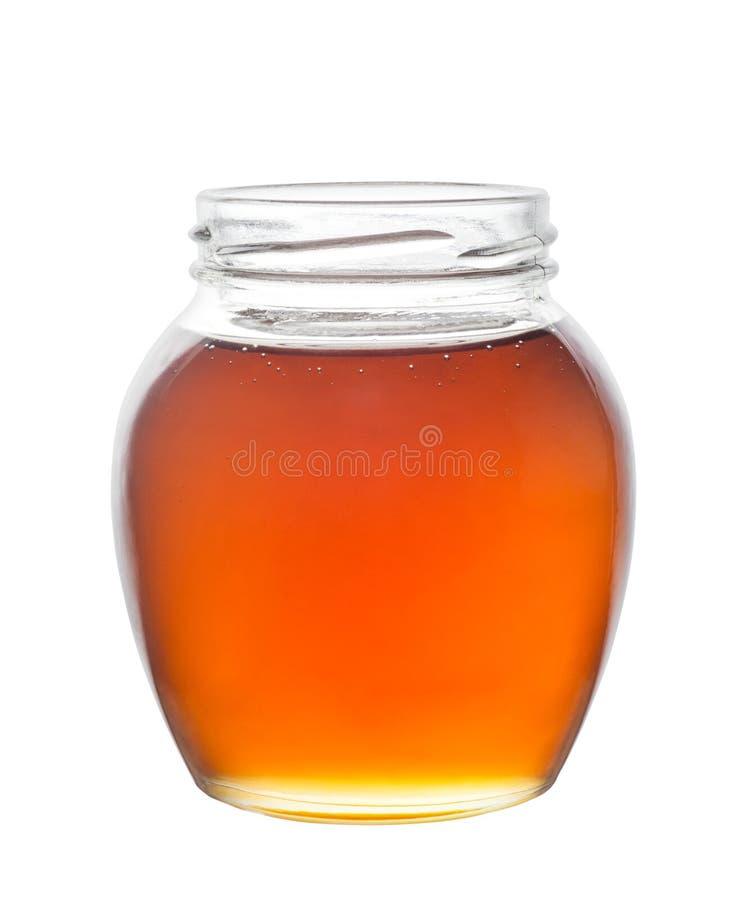Honey. Glass jar full of honey isolated on white background royalty free stock photo