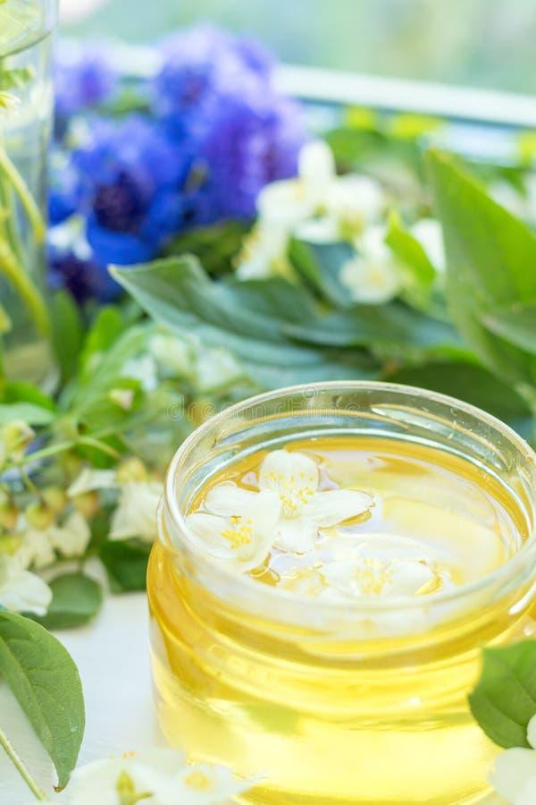 Honey in glass jars stock photos