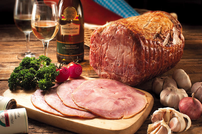 Honey Glazed Ham. Honey brown glazed ham prepared with organic ingredients and to served with wine stock images