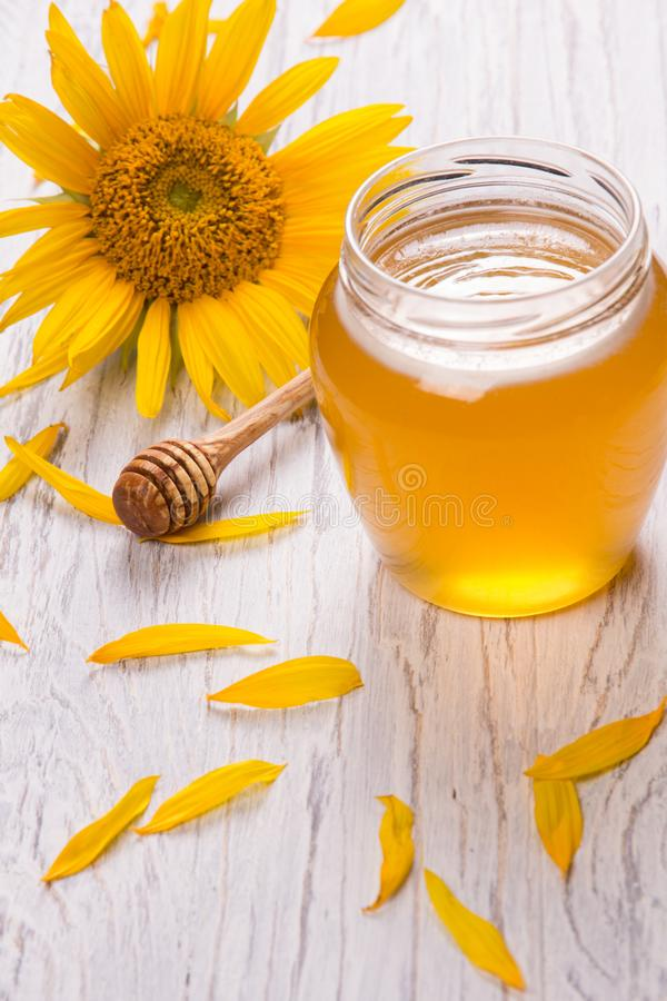 Free Honey In A Glass Jar Stock Photo - 121426840