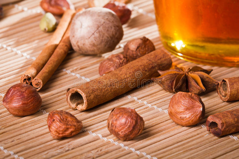Honey jar and all sorts of nuts royalty free stock images