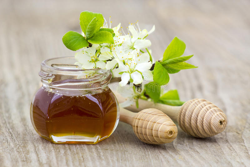 Download Honey In A Jar, Flowers And Honey Dippers Stock Photo - Image of sugar, background: 39514316