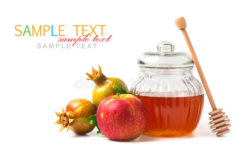 Honey jar and fresh apples with pomegranate on white background stock images