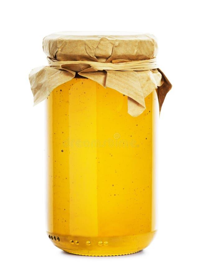 Honey jar. Isolated on white background stock photography