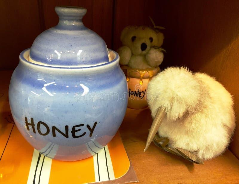 Honey jar and kiwi stuffed toy stock image