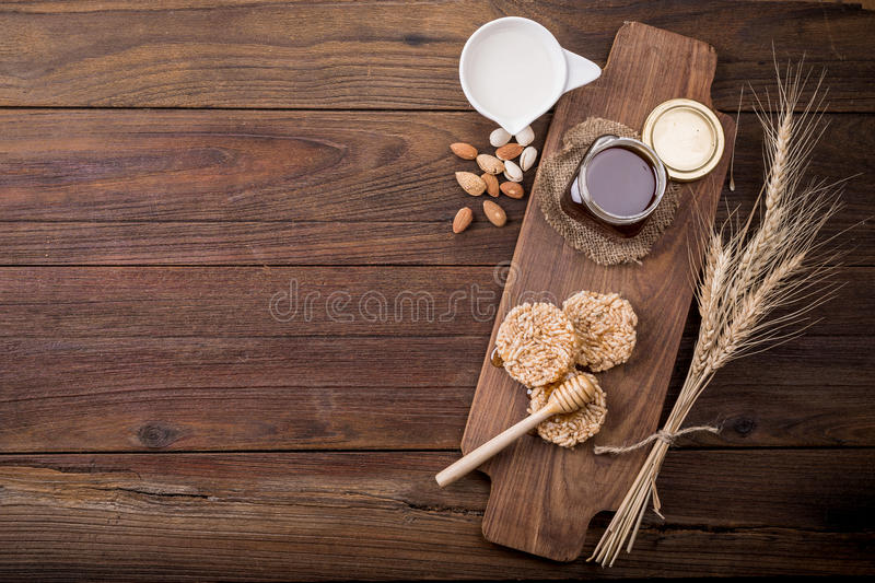 Honey in a jar, on an old vintage planked wood table from above. royalty free stock photography