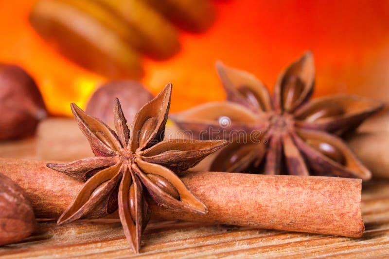 Honey jar, star anise and cinnamon bark stock image