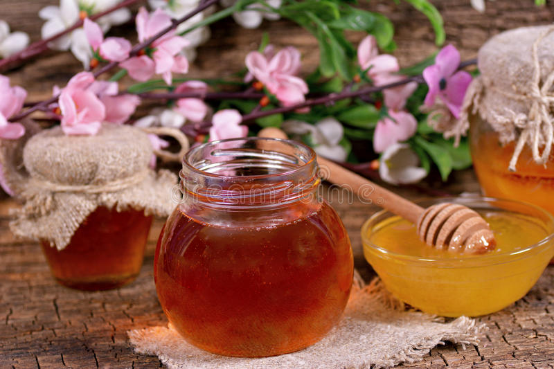 Honey in a jar royalty free stock photography
