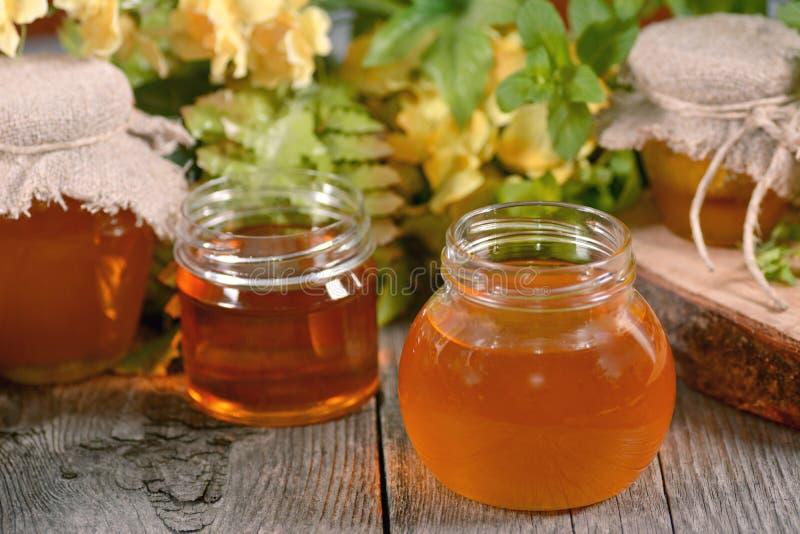 Honey in a jar royalty free stock photos